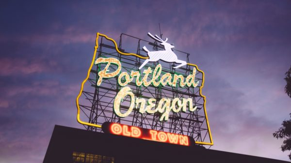 A neon sign that reads Portland, Oregon; a city with weird things